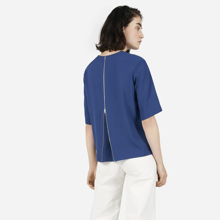 Laser-cut hems give this oversized top an exceptionally clean look, while the functional two-way zipper in back can be opened for a more A-line shape.