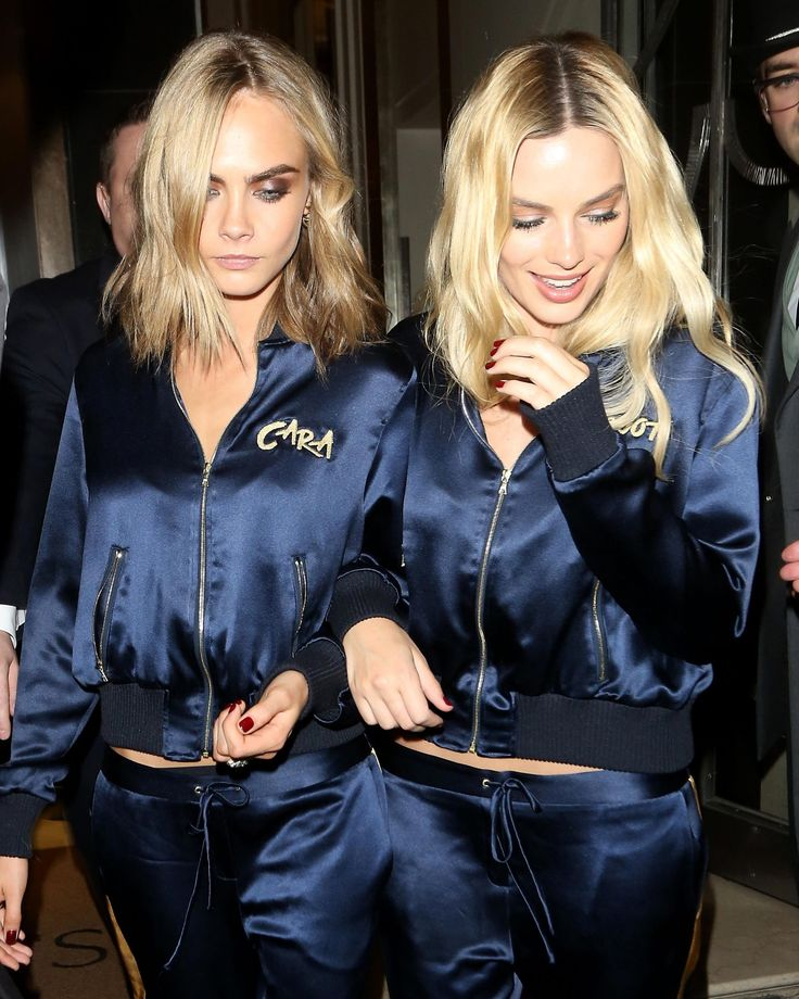 Cara Delevingne and Margot Robbie in matching embroidered silk tracksuits, and matching rumpled strands and darkened roots.
