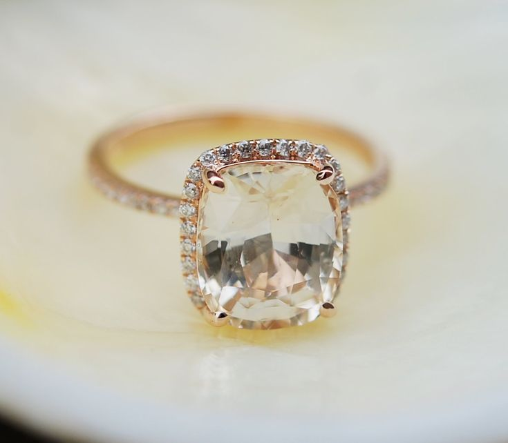 Champagne sapphire ring by Eidelprecious.  This ring features a 4.85ct cushion sapphire. The stone is unbelievable - clear and beautiful, SI. It is a natural non-treated stone, very rare.  The color is sparkling champagne Very pretty!  This beauty is set in a 14k rose gold diamond setting, TDW 0.25