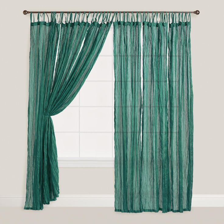 Our Storm Green Crinkle Voile Curtains provide