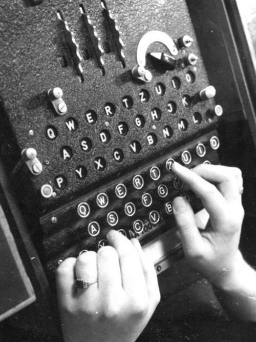 """""""An Enigma Machine in use in 1943. The Enigma was a complex cryptography tool used by the Axis - and cracked by the allies - in World War II."""""""