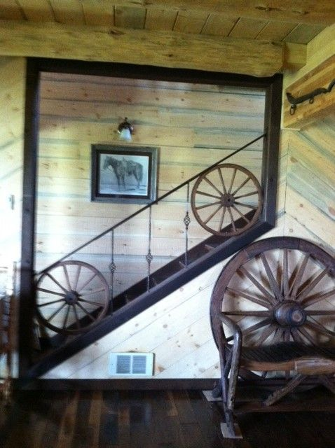 Our decor wheel incorporated into the stair railing - great Western decor idea! http://www.hansenwheel.com/store/wheels-repair/decor-antique-wheels/standard-wood-hub-wagon-wheel.html