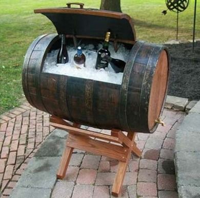Wine Barrel Cooler  While half barrels are handy, a full-size wine barrel can make a distinctive outdoor holding area for ice and drinks. Placed on a sawhorse and outfitted with a simple hinged door and hose bib drain.