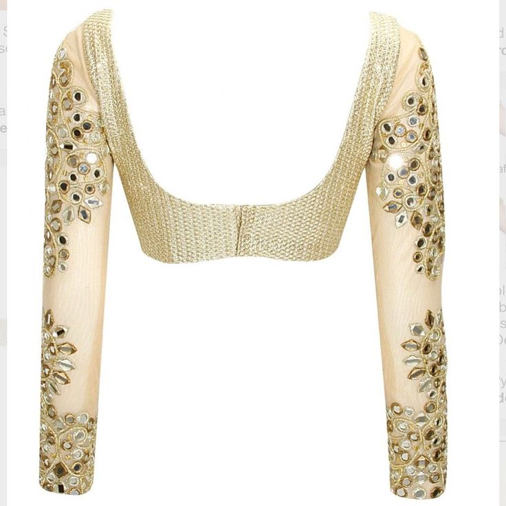 A cream and gold mirrorwork blouse via @perniaspopupshop