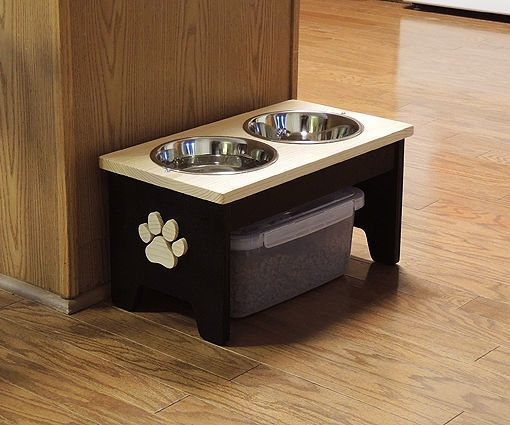 """Your dog will love this raised Dog Bowl Stand. It's easy to make with just a jig saw and a drill. Watch my video below, then click here to visit my website where you can download the free plans.Supplies: 3/4"""" lumber, paint, glue, screws, nails, 2 bowls, 1 containerTools: Drill, Jig Saw"""