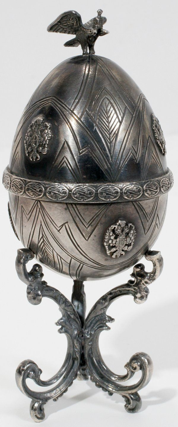 "FABERGE RUBY & SILVER EGG SHAPED BOX H 4 3/4"". Click through for photos of interior."