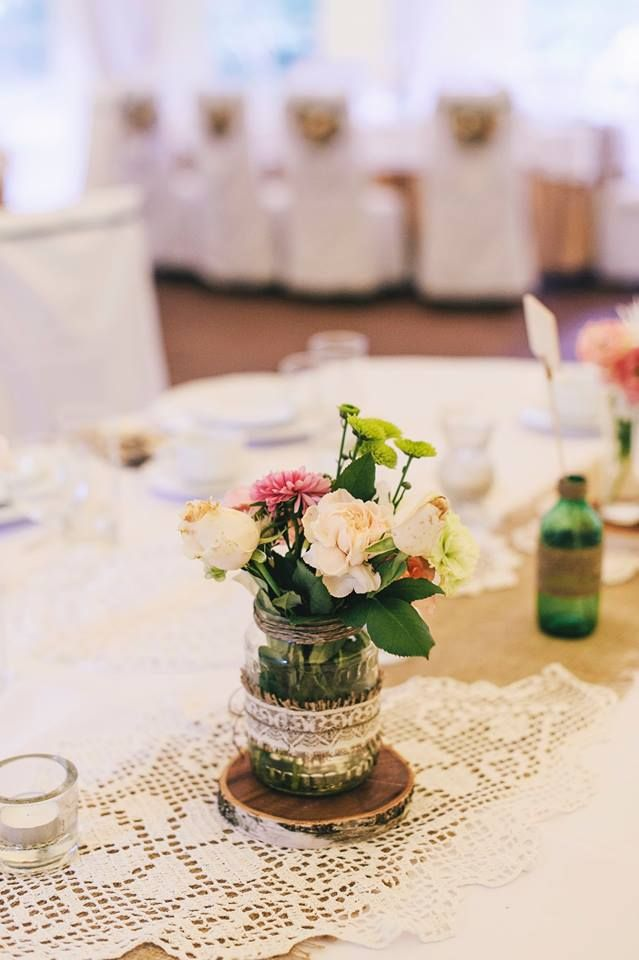 Burlap runner, old grandma's lace doilies and mason jars with garden flowers - Oh Happy Day!