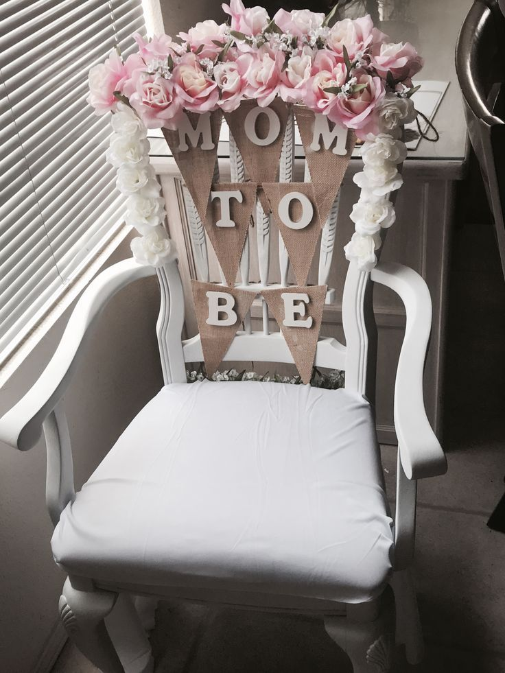Baby shower chair idea. Flowers from Walmart , Wood letters from Michaels ,Wood chair was painted with flat white spray ( $25 dollars )