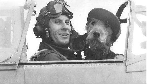 "Major Roland F. Wooten, USAAF, with his Airedale Terrier, ""Sgt. Monk Hunter"". Roland was killed in an aviation accident in 1968."