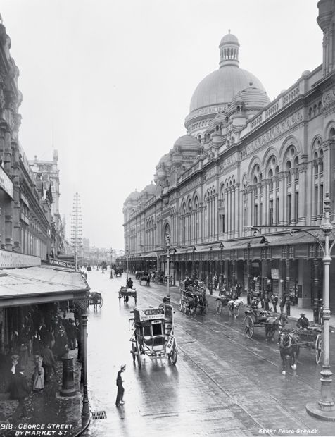 The Queen Victoria Building, ca. 1905-17. Designed by the Sydney City Architect, George McRae, and built on the site of the original central markets, the grand Romanesque-style shopping arcade that replaced the markets gave only a passing nod to the site's previous function.