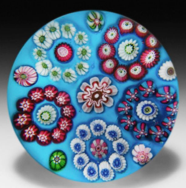 Antique Clichy circular millefiori garland on opaque cerulean blue ground glass paperweight by  Clichy