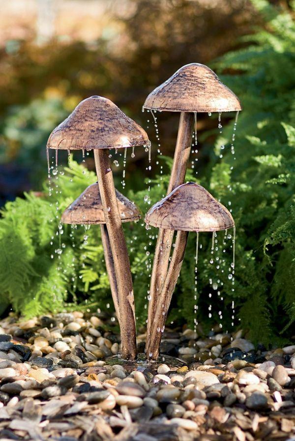 fontaine de jardin design aux sculpture en bronze de champignons et bassin de cailloux