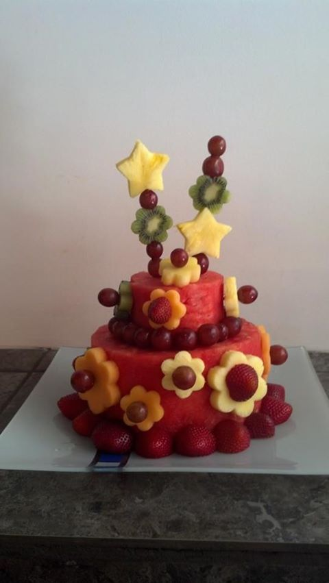 """watermelon """"cake"""" , a great alternative for healthy desserts. Have seen pictures with sliced apples around it, too."""
