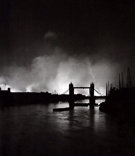 Tower Bridge silhouetted by fires on Saturday 7th September 1940. This day became known as 'Black Saturday'. The Luftwaffe arrived in the late afternoon during a day of very good weather when many Londoners were on the streets enjoying the sunny weather. The sirens first started at 16.43 at the start of a twelve-hour attack. The 'all clear' was sounded at 05.00 on September 8th. In this raid 430 people were killed and over 1600 were seriously wounded.