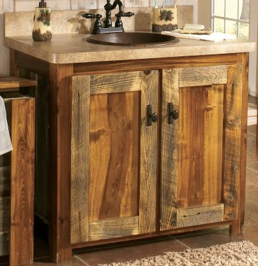 Reclaimed wood cabinet. Like the doors and the use of the dark metal sink. Cabinet doors to match the metal are smart choice.