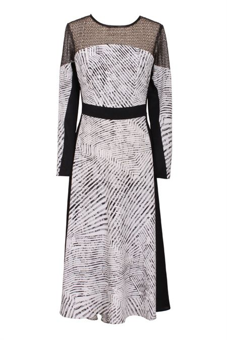 The Instinctual print is a monochrome design that takes the delicate texture of our Covet Lace and breaks it into a multi directional stripe for a magnetic and flattering effect. The fluid yet contemporary feel of this midi dress with long sleeve and flared skirt is sharpened with a slick black waistband and side panels. The yoke and shoulders are inlaid with a mesh French lace. The neck is bound in leatherette and the back features a luxe rose gold zip. Work this sexy effortles…