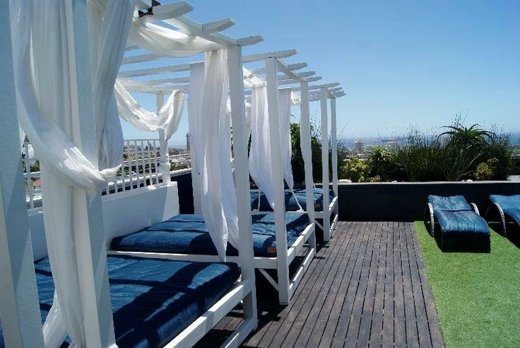 Roof terrace with pool and pool loungers at Cape Royale in Green Point