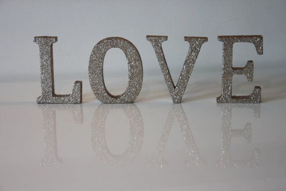 "Glitter Letters & Numbers Love token/Birthday/celebration/Gift/Corporate Lightweight MDF characters which are given a coating of champagne-coloured glitter to stunning effect. Chose individual letters, those of a couple or our favourite: ""LOVE"" to create a beautiful display. Why not go for it, spell out a special message or date. The options are endless! If ordering 3 characters or more we are able to offer a 10% discount. Product Specifications: Each MDF letter sta..."