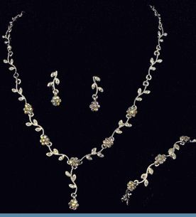3PC Silvertone Necklace, Earrings & Bracelet Set Accented with Iridescent Rhinestones