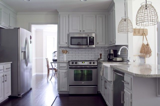 white rustic kitchen: Cottages Kitchens, Weekend Projects, Kitchens Design, Lights Fixtures, Vintage Lights, White Subway Tile, Pendants Lights, Wire Baskets, White Kitchens