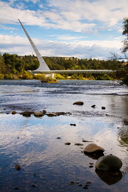 The Sundial Bridge (also known as the Sundial Bridge at Turtle Bay) is a cantilever spar cable-stayed bridge for bicycles and pedestrians that spans the Sacramento River in Redding, California/  Santiago Calatrava