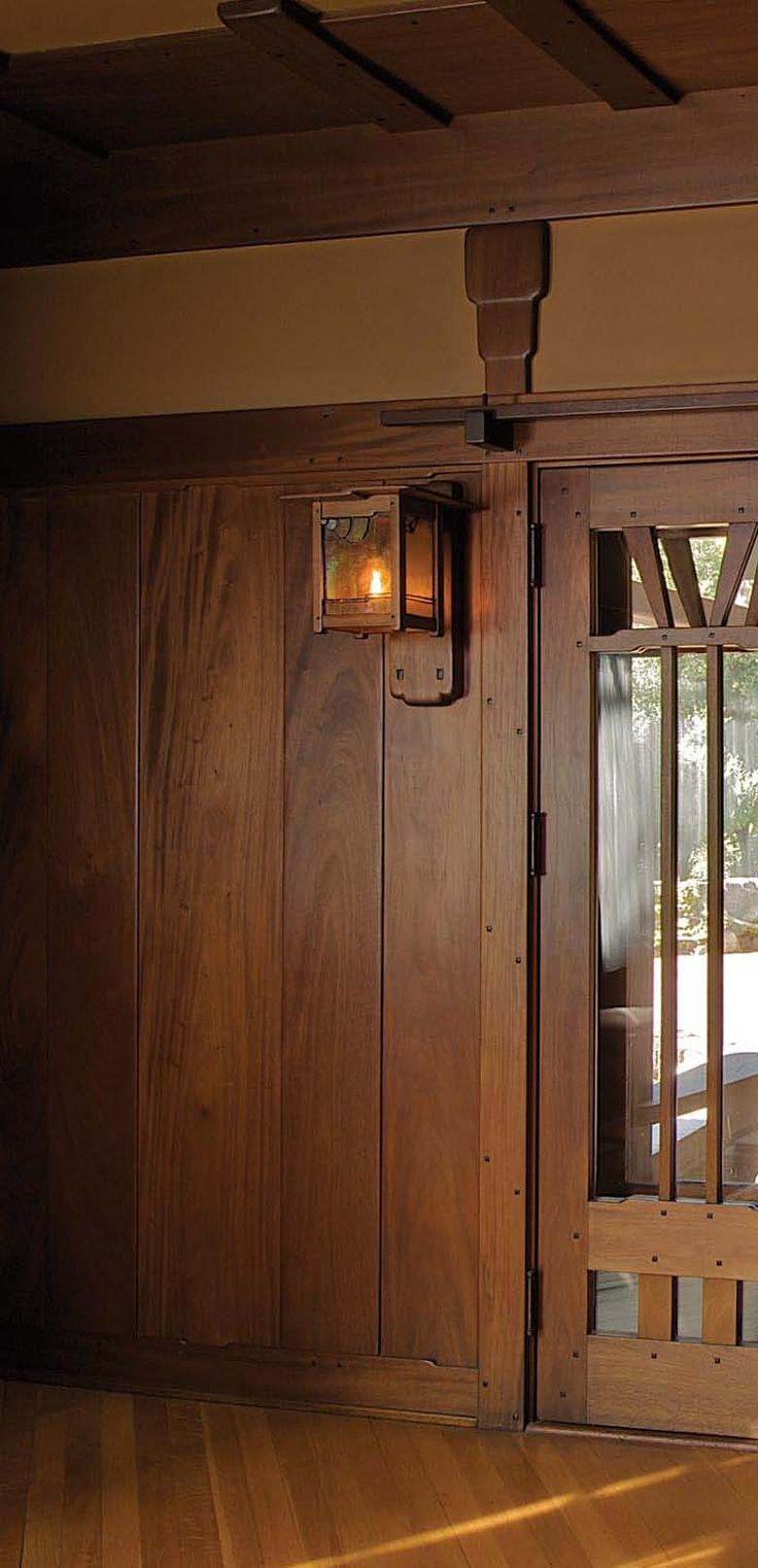 Love the wooden lantern. Blends Into the paneling and would love even more with an Edison bulb.