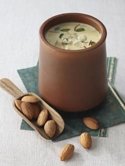 Badam milk is a creamy nutty flavoured milk shake or beverage recipe. Badam milk is prepared with crushed badam or almonds mixed with sugar, cream, milk and other dry fruits. Serve badam milk chilled during summers as a cooling healthy drink.