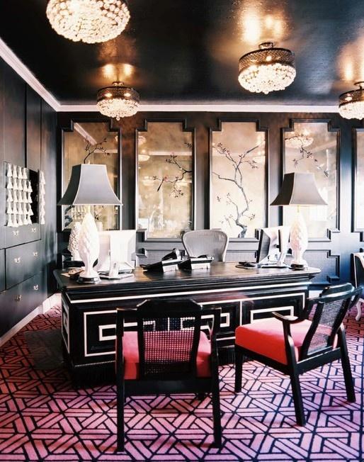 Black lacquered walls, patterned carpet, crystal lighting