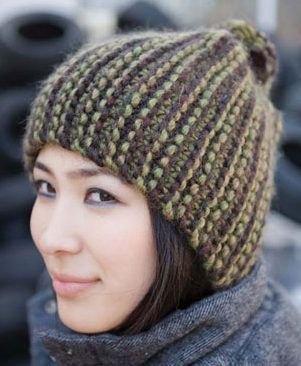 Free Knitting Pattern for Jordan Hat - This easy hat from Berroco features two color garter stitch stripes, one with multi-color yarn, to create the illusion of complex striping. Looks like it is knit sideways and then seamed. Designed by Cirilia Rose