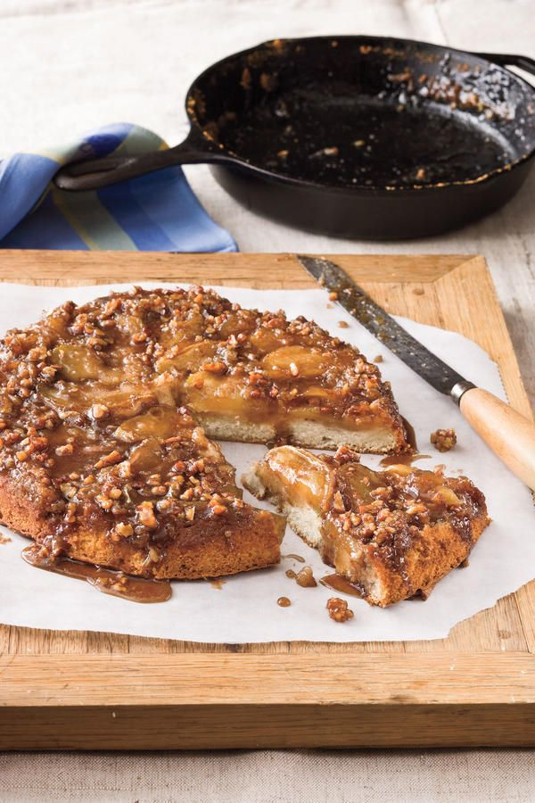 Upside-Down Caramelized Apple Cake - Cooking in Your Cast Iron Skillet - Southernliving. Recipe: Upside-Down Caramelized Apple Cake  The brown sugar, apple, and pecan mixture that's cooked in the skillet and then topped with a spiced cake batter become a gooey, rich topping for the cake when it's inverted.
