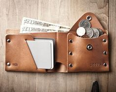 There are two types of men in this world, those that put their bills directly into their wallet and those that fold their bills first. This men's wallet was designed for the gentlemen who prefer to fold first and organize a bit more. By creating two separate sides to the wallet you can fold your cash on one side and keep receipts tucked in on the other, while your cards are safe and secure in front. As with all of my leather wallet designs I chose to favor the durability of Full-Grain…