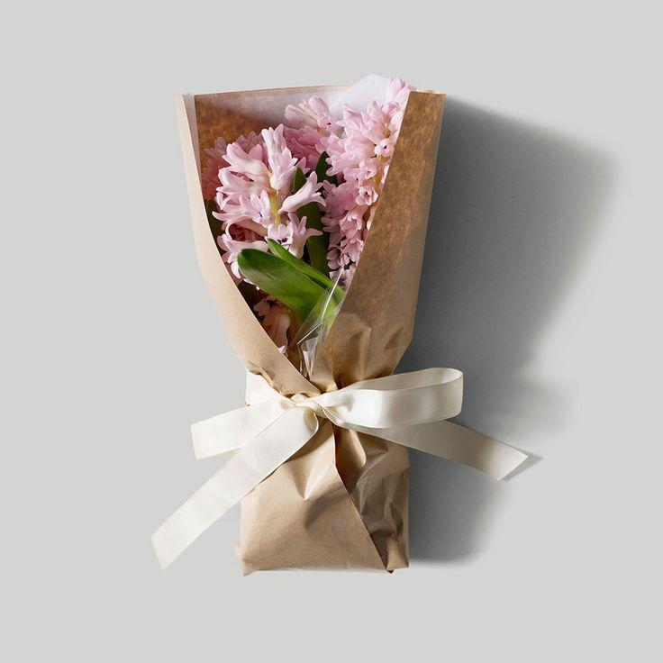 Wrapped bunch of flowers Gardenbird Flowers Web Shop | Art Direction & Photography | Lynda Evans