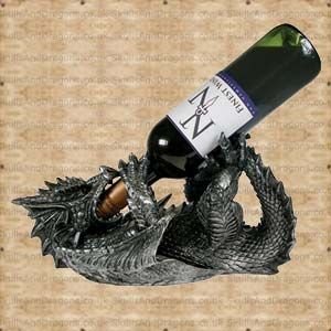 A silver dragon lying on back, when holding a wine bottle in its mouth simulates the dragon drinking wine. Wine bottle not included. Fits a standard size wine bottle. Diameter bewteen its arms is 6cm. Guzzlers Dragon Bottle Holder brought to Skulls and Dragons by Nemesis Now.    Height : 18 cm    Width : 16 cm    Length : 32 cm    Weight : 1800.00g    Made from resin £20.99