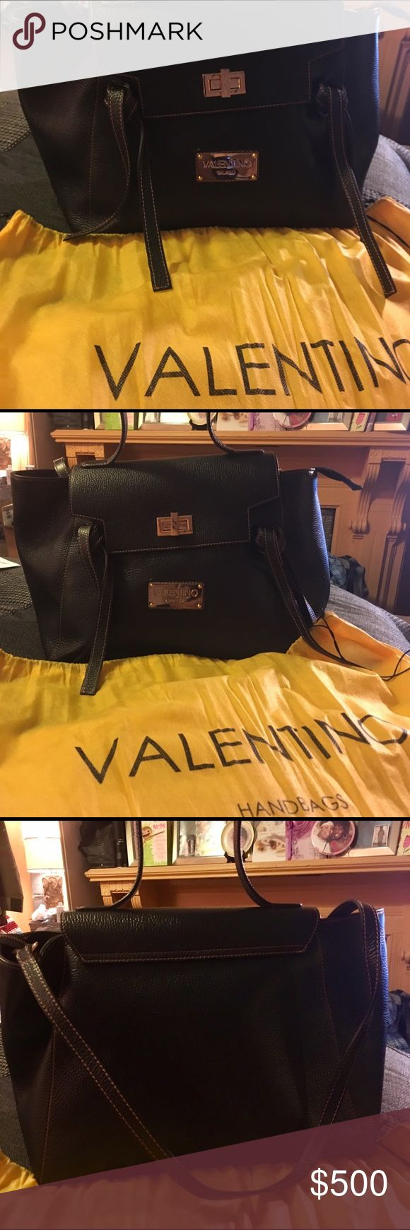 Leather Valentino Bag Good condition. Great leather. Zipper compartment and pockets inside. Slight loss of shape and few scratches on gold hardware twist. Handle and detachable strap. Great everyday bag or anything else! Mario Valentino Bags Totes