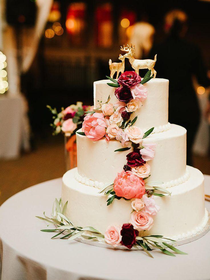 elegant, floral cascade wedding cake in soft, romantic hues