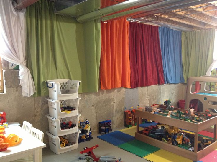 brighten up an unfinished basement playroom with 4 twin flat sheets