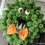 Craftaholics Anonymous® | Pinecone Monster Halloween Wreath Tutorial  Going to make one of these for our front door. He's so cute! lol