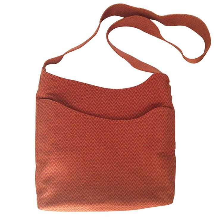 Is it an HERMES ? Yes it is . Rare HERMES model. Cross body bag in orange textured fabric . In rare price in mygoodcloset.com!
