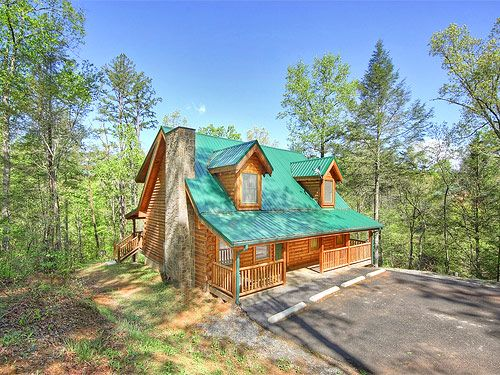 Hidden Pleasures - This cabin offers the finest amenities, such as a home theatre with surround sound, pool table, foosball table, seven satellite TV's, two jacuzzi tubs, hot tub, gas fireplace, outdoor wood firepit, fully equipped kitchen, and much more.