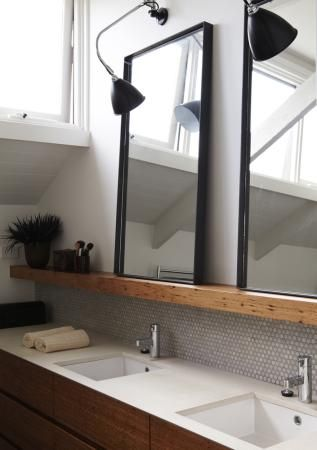 bathroom with wood ledge & leaning rectangle mirrors
