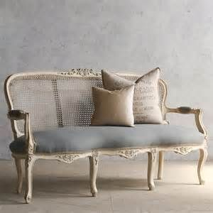 antique cane back settee.