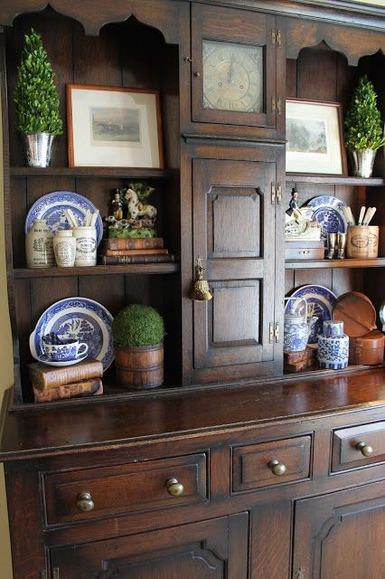 Lovely antique Welsh cupboard with a built-in clock. Perfectly appointed with appropriate accessories.