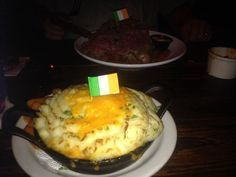 SHEPHERD'S PIE McGuire's Irish Pub 2 Lbs ground beef, 1 cup diced onion, 1 cup diced carrots, 1 cup diced celery, 1 1/2 cup corn, 2 garlic cloves minced, salt/pepper to taste, 1/2 tsp nutmeg, 8 oz beef broth, 2 Tbs butter mixed with 2 Tbs flour, 2 Lbs mashed potatoes. Cook beef add next 8 ingredients, saute 8 mins, add broth stir in flour mixture, pour into baking dish, top w/corn, then potatoes, brush with butter, bake @ 325 30-54 mins.