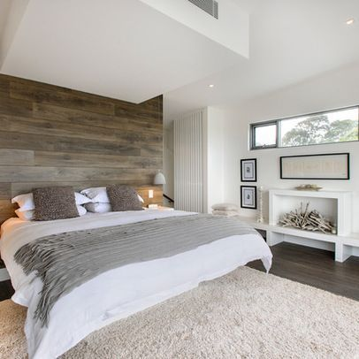 Bedroom wrap beams with reclaimed wood and installed wood above fireplace. White & natural colors. Love the wood and layout