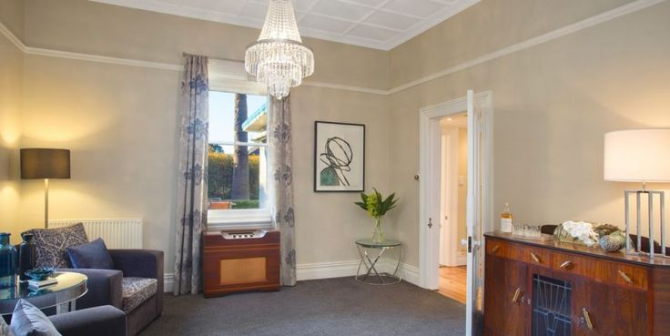 Huge double sitting room with chandeliers
