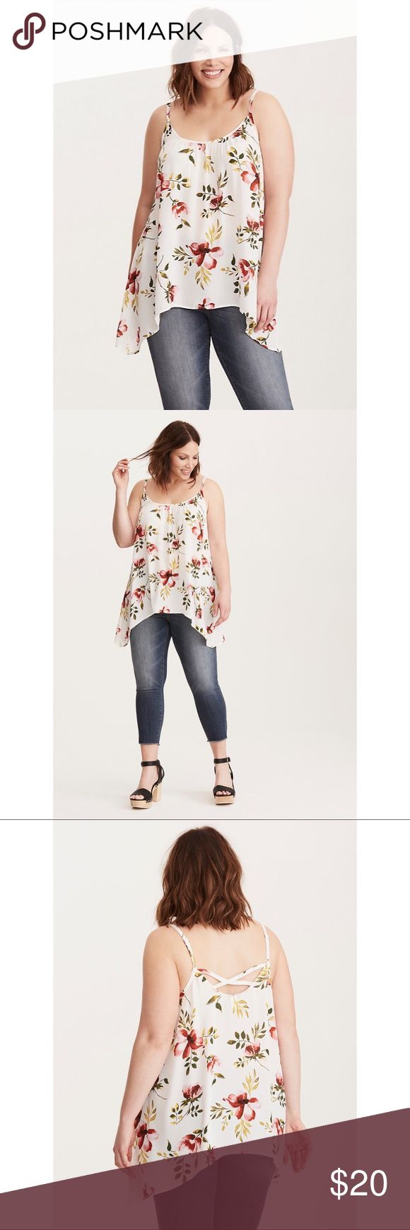 """NWT Torrid Floral Cami Top This top tends to elicit """"ooohs!"""" It might be the watercolor-inspired floral print on the totally sheer white georgette. It could possibly be the swingy silhouette caused by a flowy sharkbite hem and pleated neck. But we're pretty sure it's the strappy crossback.  Model is 5'9.5"""", size 1 * Size 1 measures 29 1/4"""" from shoulder * Polyester * Wash cold, dry low * Imported plus size top  ➡️No Trades. ➡️No Lowball Offers. ➡️No Holds. ➡️Bundle and save! torrid Tops…"""