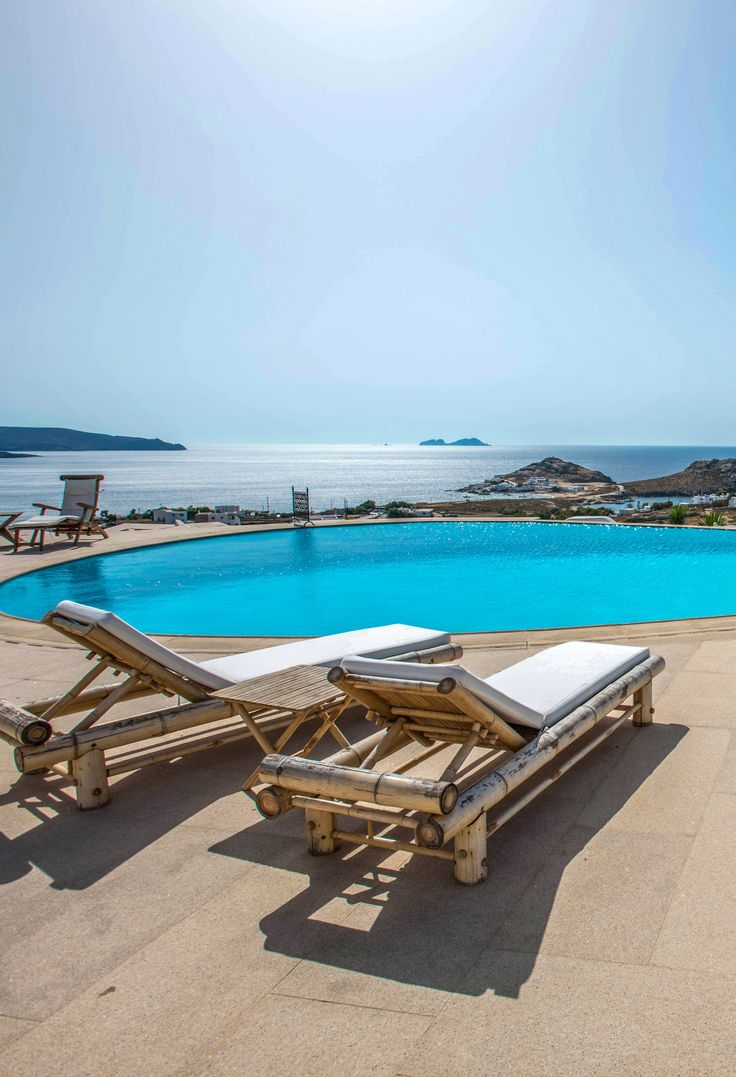 Villa Alegria in Mykonos, Greece.ALEGRIA provides a large infinity lake shaped pool (22m) with heated jacuzzi, a pool lounge area with BBQ, a chapel, helipad, modern gym and a spa room. A maximum of 30 guests can be accommodated in the 13 en-suite bedrooms.  #mykonos #luxurytravel #luxuryvilla #rental #urlaub #reise #griechenland #griechenlandurlaub #travelgram #bestvacations #feriennhaus #greece #travel