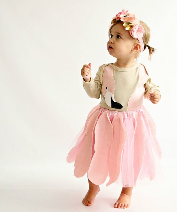 This adorable flamingo costume will definitely be the hit of October 2015. It features a sweet pink tutu embellished with 6 large pink felt