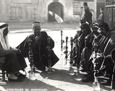 Photo post-card by V. Derounian,1930, in Aleppo/Syria of an outdoor Cafe of Narghile Smokers [Water-Pipe, Shisha, ], widely used all over th...