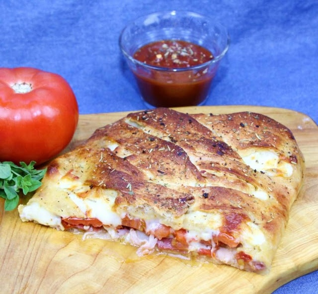 """Easy Stromboli - Add this recipe to your """"something easy and fast to make on a week night"""" list... because it is super simple to throw together, and very family/kid friendly.  This really is both easy and good! And I threw a ton of veggies in there. I also used an oil/balsamic vinegar/Italian seasoning mix instead of Italian dressing.  Also used whole foods bakery pizza dough instead of canned."""